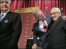 George W. Bush laughing with friend and 9/11 Commission chairman Henry Kissinger. WTC 7 leaseholder Ppeter Peterson walks in front of them.