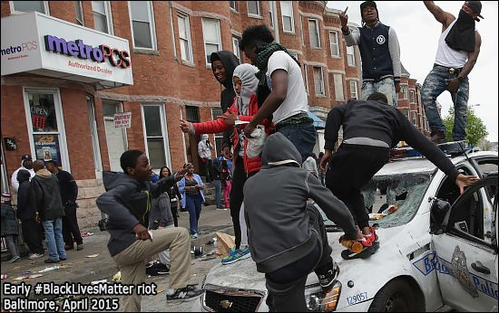 Baltimore Black Lives Matter riot. Dancing on a police car.
